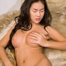 Busty Thai babe Emiko totally nude